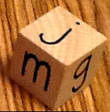 wooden block with letters